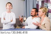 Купить «Serious parents scolding son», фото № 30846418, снято 12 ноября 2017 г. (c) Яков Филимонов / Фотобанк Лори