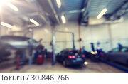 Купить «car service station bokeh», фото № 30846766, снято 1 июля 2016 г. (c) Syda Productions / Фотобанк Лори