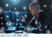 Купить «hacker with smartphone and computers in dark room», фото № 30846782, снято 9 ноября 2017 г. (c) Syda Productions / Фотобанк Лори