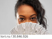 Купить «african american woman hiding face behind money», фото № 30846926, снято 2 марта 2019 г. (c) Syda Productions / Фотобанк Лори