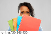 Купить «shy african american student woman with notebooks», фото № 30846930, снято 2 марта 2019 г. (c) Syda Productions / Фотобанк Лори