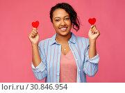 Купить «happy african american woman with red hearts», фото № 30846954, снято 2 марта 2019 г. (c) Syda Productions / Фотобанк Лори