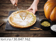 Купить «woman cooks pumpkin pie», фото № 30847162, снято 23 ноября 2018 г. (c) Майя Крученкова / Фотобанк Лори