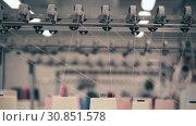 Купить «View of spools of white thread on knitting device», видеоролик № 30851578, снято 25 мая 2019 г. (c) Гурьянов Андрей / Фотобанк Лори