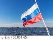Купить «Flag of the Russian Federation illuminated by the sun», фото № 30851654, снято 25 мая 2019 г. (c) Дмитрий Тищенко / Фотобанк Лори