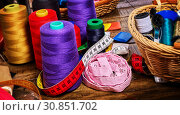 Купить «Sewing accessories coil threads and measuring tape in basket supplies», фото № 30851702, снято 19 мая 2019 г. (c) Gennadiy Poznyakov / Фотобанк Лори