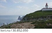 Купить «Picturesque spring Cabo da Roca landscape with lighthouse, Sintra-Cascais Natural Park, Portugal», видеоролик № 30852050, снято 13 мая 2019 г. (c) Яков Филимонов / Фотобанк Лори