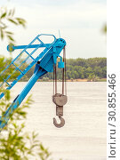 Large hook construction crane on the background of the river. Стоковое фото, фотограф Акиньшин Владимир / Фотобанк Лори