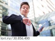 Купить «Portrait of busy man rushing to important meeting», фото № 30856490, снято 20 апреля 2017 г. (c) Яков Филимонов / Фотобанк Лори