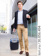Купить «Portrait of cheerful male standing with bag», фото № 30856494, снято 20 апреля 2017 г. (c) Яков Филимонов / Фотобанк Лори