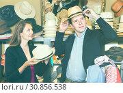 Купить «young wife and husband choosing dress hats in the store», фото № 30856538, снято 2 мая 2017 г. (c) Яков Филимонов / Фотобанк Лори