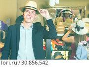 Купить «portrait of guy try on bucket hat at store», фото № 30856542, снято 2 мая 2017 г. (c) Яков Филимонов / Фотобанк Лори