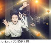 Купить «Girl wearing virtual reality glasses», фото № 30859718, снято 29 января 2019 г. (c) Яков Филимонов / Фотобанк Лори