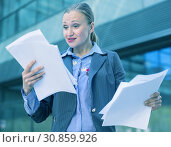 Купить «Professional woman in jacket working with documents», фото № 30859926, снято 6 мая 2017 г. (c) Яков Филимонов / Фотобанк Лори