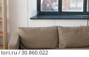 Купить «man with floor lamp arranging room at new home», видеоролик № 30860022, снято 24 мая 2019 г. (c) Syda Productions / Фотобанк Лори