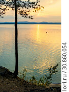 Купить «Summer sunset landscape - stone cliff and lake lit by sunset light», фото № 30860054, снято 16 августа 2013 г. (c) Зезелина Марина / Фотобанк Лори