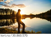 Купить «sunset fishing. fisher with spinning rod», фото № 30860570, снято 8 мая 2019 г. (c) Дмитрий Калиновский / Фотобанк Лори