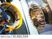 Купить «Spiral gear milling machine work. CNC grinding machine in metalwork industry», фото № 30860594, снято 27 мая 2019 г. (c) Дмитрий Калиновский / Фотобанк Лори