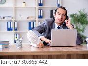 Купить «Leg injured male employee in the office», фото № 30865442, снято 3 мая 2019 г. (c) Elnur / Фотобанк Лори