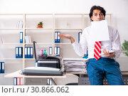 Купить «Young employee making copies at copying machine», фото № 30866062, снято 14 декабря 2018 г. (c) Elnur / Фотобанк Лори