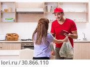 Купить «Young male courier in food delivery concept», фото № 30866110, снято 22 февраля 2019 г. (c) Elnur / Фотобанк Лори