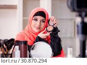 Купить «Beauty blogger in hijab recording video for her blog», фото № 30870294, снято 5 февраля 2019 г. (c) Elnur / Фотобанк Лори