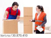 Купить «Professional movers doing home relocation», фото № 30870410, снято 22 января 2019 г. (c) Elnur / Фотобанк Лори