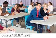 Купить «Adult students discussing lesson», фото № 30871278, снято 8 мая 2018 г. (c) Яков Филимонов / Фотобанк Лори
