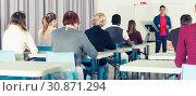 Купить «Students with teacher studying in classroom», фото № 30871294, снято 8 мая 2018 г. (c) Яков Филимонов / Фотобанк Лори