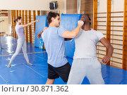 Купить «Two men practicing self defense techniques», фото № 30871362, снято 31 октября 2018 г. (c) Яков Филимонов / Фотобанк Лори