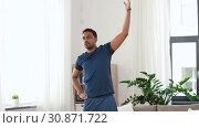 Купить «indian man exercising and leaning at home», видеоролик № 30871722, снято 27 мая 2019 г. (c) Syda Productions / Фотобанк Лори