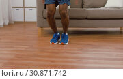 Купить «indian man doing jumping jack exercise at home», видеоролик № 30871742, снято 27 мая 2019 г. (c) Syda Productions / Фотобанк Лори