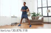 Купить «indian man exercising and leaning at home», видеоролик № 30876118, снято 27 мая 2019 г. (c) Syda Productions / Фотобанк Лори