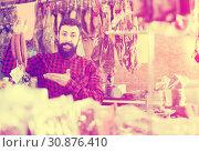 Купить «Guy deciding on best sausage», фото № 30876410, снято 16 ноября 2016 г. (c) Яков Филимонов / Фотобанк Лори