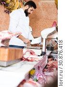 Купить «shop assistant carving meat», фото № 30876418, снято 16 ноября 2016 г. (c) Яков Филимонов / Фотобанк Лори