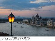 Купить «Beautiful evening view of the Parliament building and the river in Budapest in Hungary», фото № 30877070, снято 2 июня 2019 г. (c) Яна Королёва / Фотобанк Лори