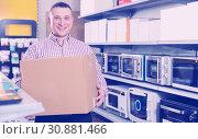 Купить «Male with purchases in household appliances section», фото № 30881466, снято 1 марта 2018 г. (c) Яков Филимонов / Фотобанк Лори