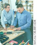 Купить «adult father teaching son сarpentry in the garage», фото № 30881634, снято 17 мая 2017 г. (c) Яков Филимонов / Фотобанк Лори