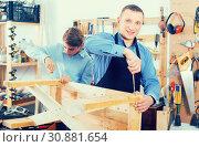 Купить «teacher and boy chiselling a wooden bench in workshop», фото № 30881654, снято 17 мая 2017 г. (c) Яков Филимонов / Фотобанк Лори