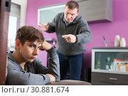 Купить «Angry father screaming at offender son», фото № 30881674, снято 8 февраля 2019 г. (c) Яков Филимонов / Фотобанк Лори