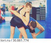 Купить «Woman is training captures with man on the self-defense course in gym.», фото № 30881774, снято 21 августа 2017 г. (c) Яков Филимонов / Фотобанк Лори