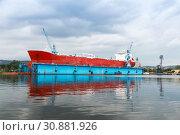 Купить «Red tanker is under repairing», фото № 30881926, снято 16 июля 2014 г. (c) EugeneSergeev / Фотобанк Лори