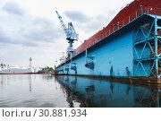 Купить «Blue dry dock with tanker inside», фото № 30881934, снято 16 июля 2014 г. (c) EugeneSergeev / Фотобанк Лори