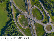 Aerial view at junctions of rural highway. Vehicles drive on roads, Moscow area, Russia. Стоковое фото, фотограф Кирилл Трифонов / Фотобанк Лори