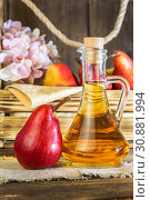 Купить «Food, vegetarianism, healthy diet food, drink. Natural juice without pulp from fresh red pear in a glass decanter, wine, liqueur and seasonal fruit harvest in a wooden box on the table», фото № 30881994, снято 2 июня 2019 г. (c) Светлана Евграфова / Фотобанк Лори