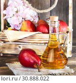 Купить «Food, vegetarianism, healthy diet food, drink. Natural juice without pulp from fresh red pear in a glass decanter, wine, liqueur and seasonal fruit harvest in a wooden box on the table», фото № 30888022, снято 2 июня 2019 г. (c) Светлана Евграфова / Фотобанк Лори