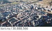 Купить «Aerial view of cityscape of La Seu d'Urgell and main historical monument - Santa Maria d'Urgell Cathedral, Catalonia, Spain», видеоролик № 30888566, снято 12 января 2019 г. (c) Яков Филимонов / Фотобанк Лори