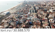 Купить «Aerial panoramic view of modern cityscape of Badalona in sunny day, Spain», видеоролик № 30888570, снято 19 января 2019 г. (c) Яков Филимонов / Фотобанк Лори