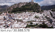 Купить «Picturesque aerial view of Zahara de la Sierra with ancient castle on rocky hill against backdrop of lake, Spain», видеоролик № 30888578, снято 18 апреля 2019 г. (c) Яков Филимонов / Фотобанк Лори