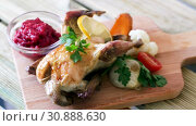 Купить «Delicious grilled hen served on wooden board with cranberry sauce broiled vegetables», видеоролик № 30888630, снято 27 августа 2018 г. (c) Яков Филимонов / Фотобанк Лори